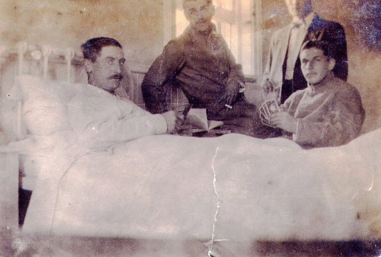 "1916 - Photograph of RNWMP member in the ""Depot"" Post Hospital with visiting Force friends (Source of photo - Vancouver Division - RCMP Veterans' Association)."