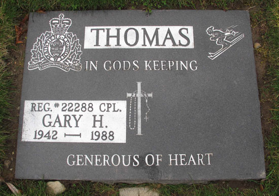 Photograph of a gravemarker of a past member with the crest of the Force appearing on the marker (Source of photo - Sheldon Boles).
