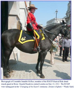 Photograph of RCMP female member on the Musical Ride standing on guard at Buckingham Palace