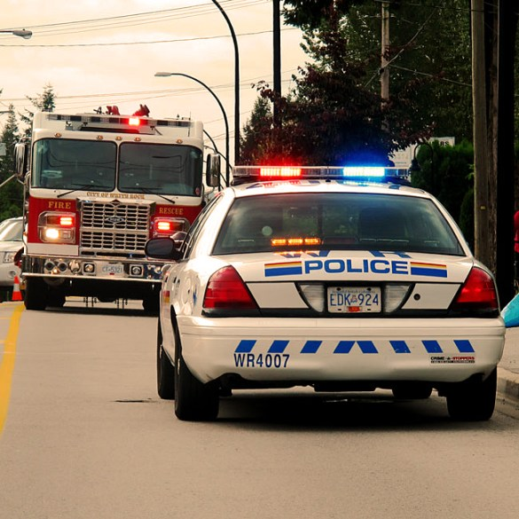 Photograph of RCMP police car with emergency equipment activated
