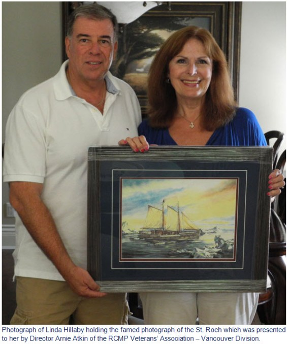 Photograph of Director Arnie Atkin presenting Linda Hillaby with a framed picture of the RCMP St. Roch schooner which her grandfather was associated with.