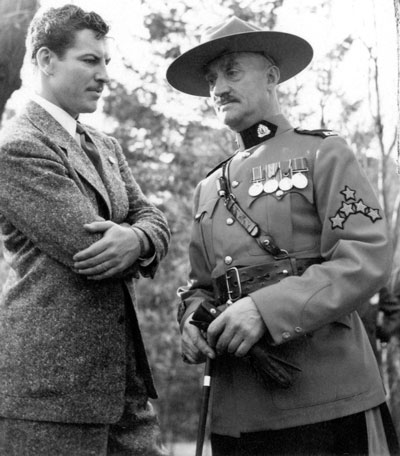 "1940 - Photograph of Actor Preston Foster (who played Sergeant Jim Britt in the North-West Mounted Police movie) and C/S/M Tim Griffin (Source of photo - RCMP Historical Collections Unit - ""Depot"" Division)"