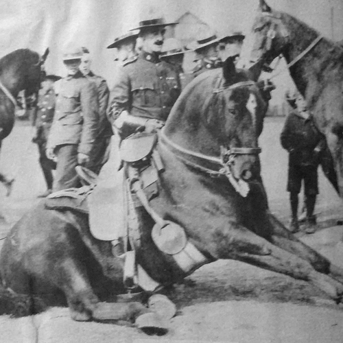 Photograph of a newspaper article illustrating RCMP S/Major Tim Griffin demonstrating his horsemanship skills