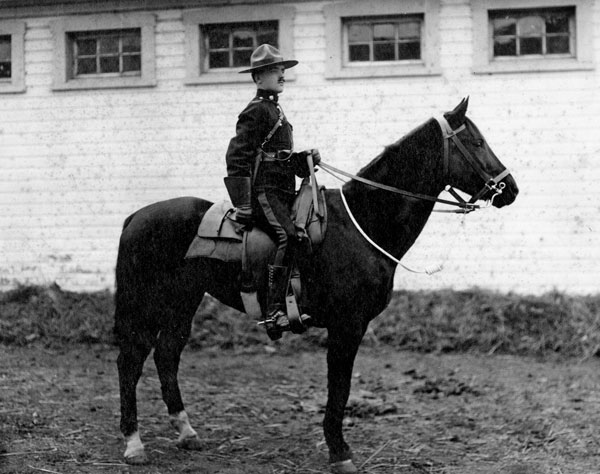 """Photograph of an unknown member on horseback at """"Depot"""" Division. (Source of photo - RCMP Historical Collections Unit - """"Depot"""" Division)"""