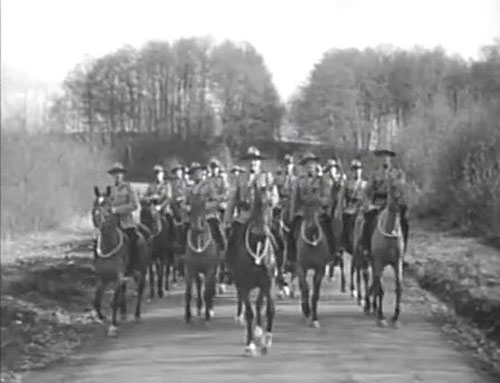 Photograph taken from the Rose Marie movies starting Nelson Eddy leading a group of RCMP members (Source of photo - Ric Hall's Photo Collection)
