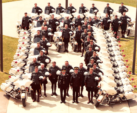"1980s - Photograph of RCMP ""E"" Division Traffic Section members with their motorcycles (Source of photo - Ric Hall's Photo Collection)."