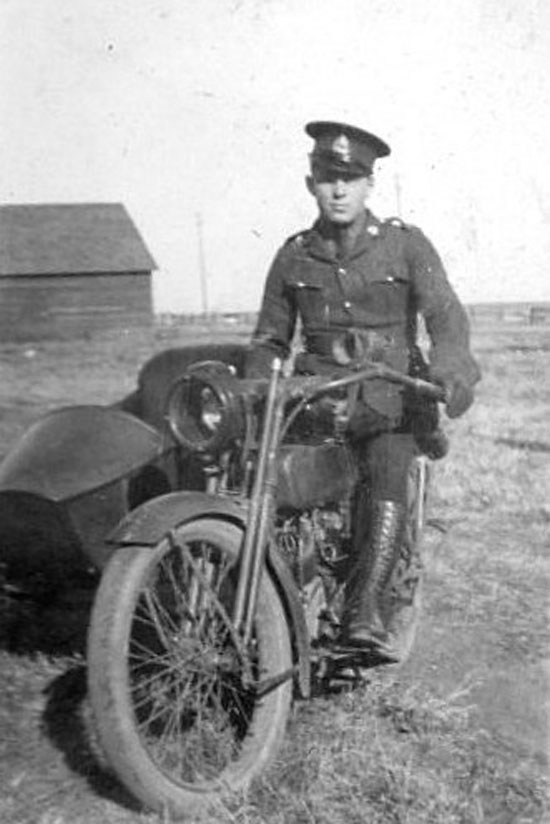 1919 - Photograph of an RCMP member operating a motorcycle (Source of photo - Ric Hall's Photo Collection)