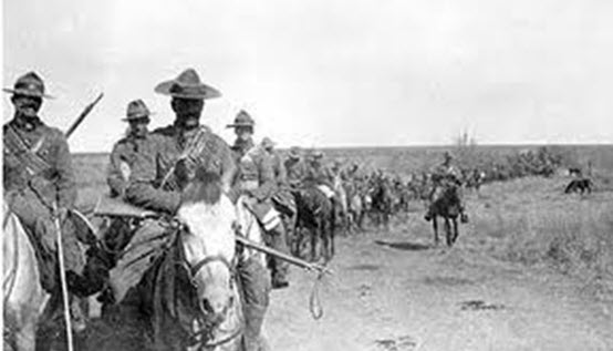 Photograph of the Second Canadian Mounted Rifles in the Transvaal, February or March 1902. This photograph shows something of the fatiguing, mostly fruitless work involved in chasing down the small bands of elusive Boer guerrillas. (Source of photo - Library Archives of Canada - NAC/PA-173029)