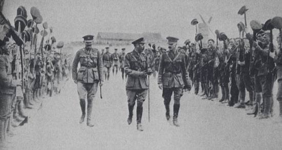 1916 - Photograph of Major General Jillian Byng, King George V accompanied by Brigadier General Edward Hilliam flanked by cheering troops. (Source of photo - RCMP Veterans' Association Vancouver Division's Photo Collection)