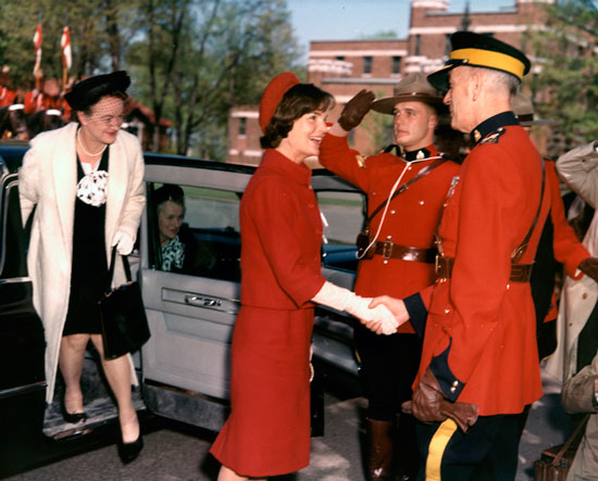 Photograph of Jackie Kennedy being greeted by Commissioner Clifford Walter Harvison (Source of photo - Ric Hall's Photo Collection)