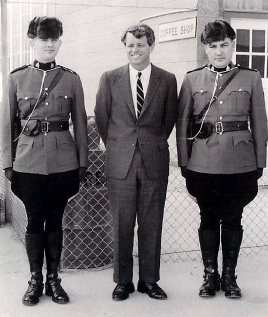 Photograph of Senator Bob Kennedy flanked by two RCMP members (Source of photo - Ric Hall's Photo Collection)