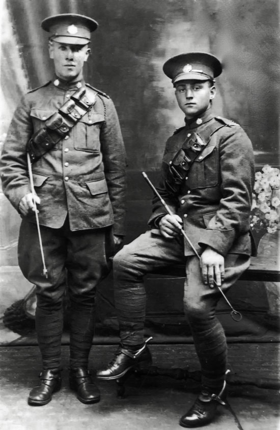 "1918 - Photograph of two RNWMP Cavalry Draft members - on the left - Trooper George Chalmers (RNWMP Reg. #7055) and right - Trooper William Richardson (RNWMP Reg. #7054). Photo taken in England. (Source of photo - RCMP Historical Collections Unit - ""Depot"" Division)."