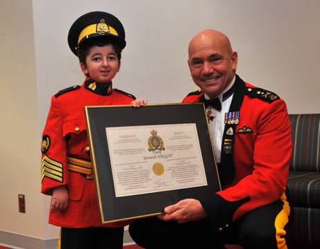 Photograph of Casey Wright with RCMP Commissioner Bob Paulson (Source of photo - Linda Wright)