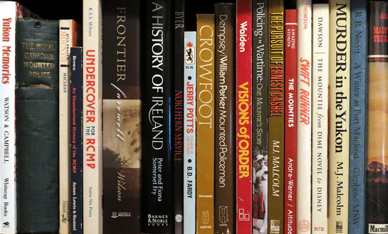 Shelf containing many books about the NWMP, RNWMP and RCMP. (Source of photo - Sheldon Boles)
