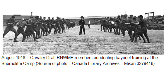 August 1918 - Cavalry Draft RNWMP members receiving bayonet training at Shorncliffe Camp in Kent England (Source of photo - Library Archives of Canada).