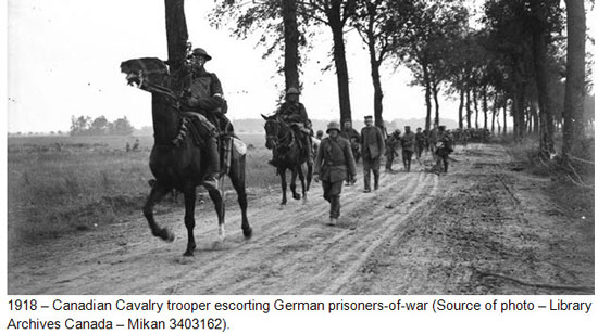 Photograph of Canadian Cavalry members escorting German and Austrian prisoners-of-war (Source of photo - Library Archives Canada).