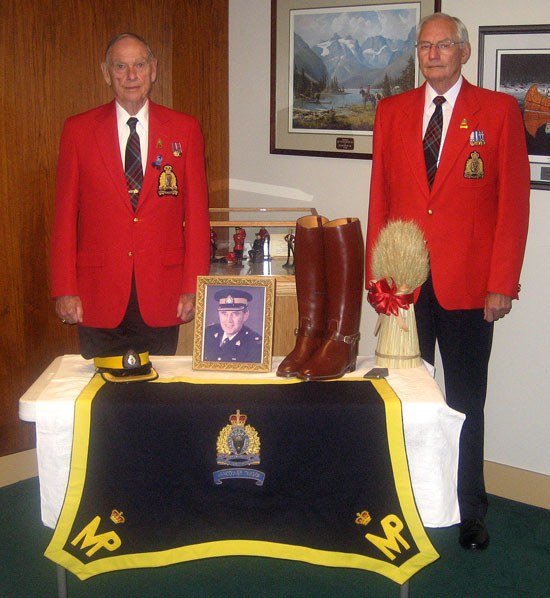 Photograph of RCMP Veterans' with a Table of Remembrance for a Veteran who has passed away (Source of photo - Dan Lemieux).