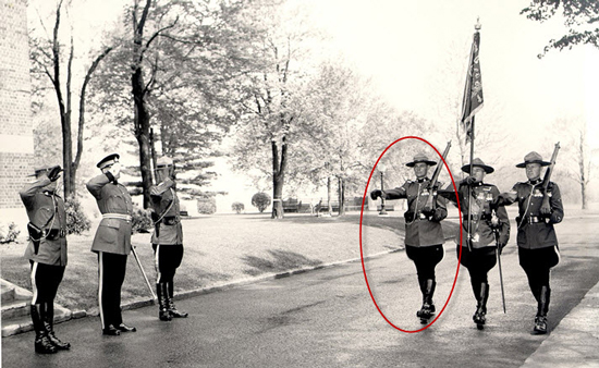 Photograph of Sgt. Bill MacRae (circled in red) part of the Guidon Escort for the Drumhead Ceremony at Rockcliffe in 1950.   The parade consisted of four Squadrons of three troops each made up of 32 members each.  (Source of photo - Ric Hall's Photo Collection).