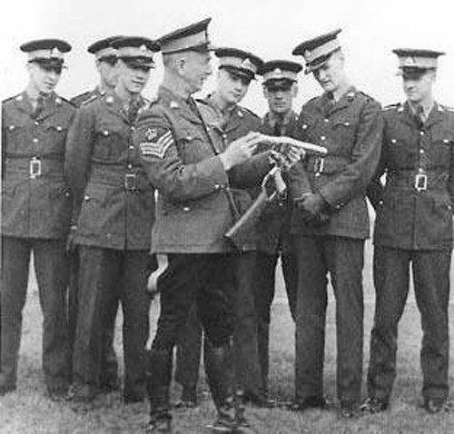 1940s - Photograph of a 'Depot' Firearms Instructor explaining to recruits on the details of the tear gas gun (Source of photo - Ric Hall's Photo Collection).