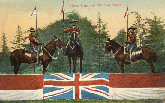 Post card of Royal Canadian Mounted Police members during a demonstration of horsemanship (Source of Photo - Ric Hall's Photo Collection).
