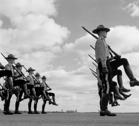 1950s Photograph of RCMP Recruits performing the command of 'marking time with a Lee Enfield rifle (Source of photo - Ric Hall's Photo Collection).