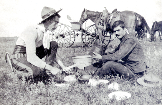 Photograph of RNWMP  members on patrol and stopping to enjoy a mid day meal (Source of photo - Ric Hall's Photo Collection).