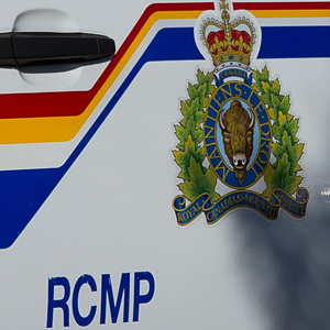 Photograph of a RCMP police car door (Source of photo - Sheldon Boles)