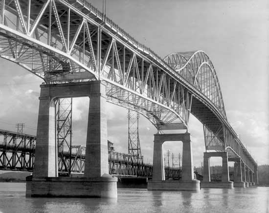 Photograph of the Pattullo Bridge at the level of the Fraser River and on the New Westminster side.
