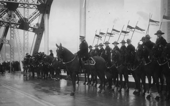 1937 - Photograph of the official opening of the Pattullo Bridge. RCMP members from Fairmount Barracks formed the mounted honour guard.