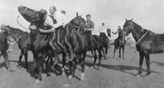 """Photograph of RCMP """"Depot"""" Division's sport event using horse. (Source of photo - Ric Hall's Photo Collection)."""