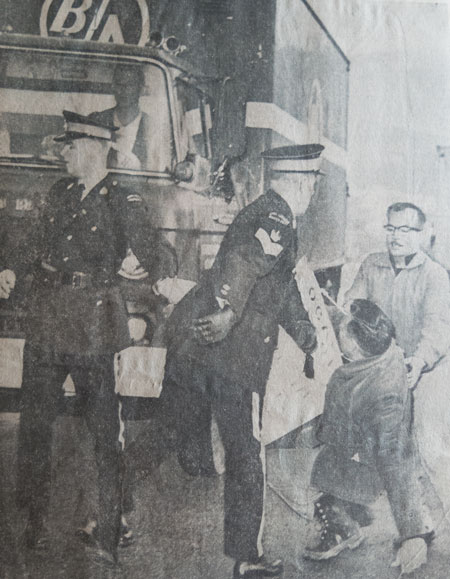Hefty shove by RCMP officer sends picket reeling back after picket refused officer's order to move from in front of British Columbia Oil Co. truck attempting to leave strikebound Burnaby plant (Source of photo - Vancouver Sun Newspaper).