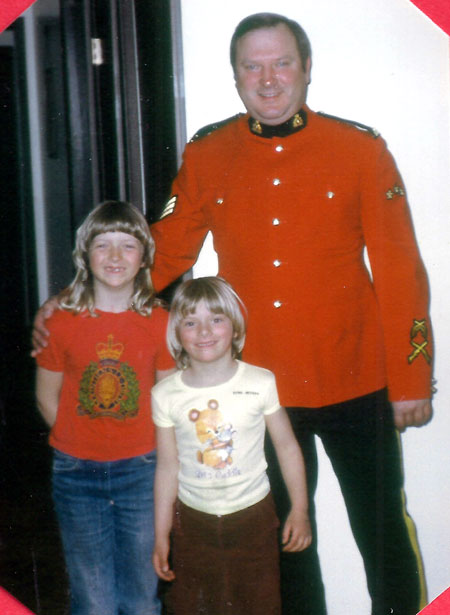 Photograph of RCMP member with his two young daughters (Source of photo - Ric Hall's Photo Collection).