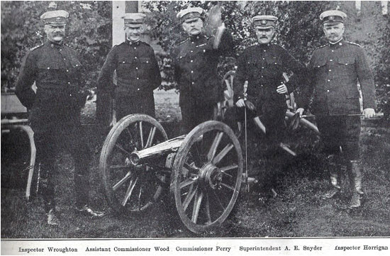 """Photograph of RNWMP members taken with a 7-pounder artilley piece at """"Depot"""" Division (Source of photo - Ric Hall's Photo Collection)."""