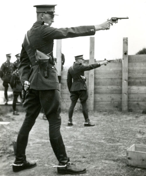 "Photograph of RCMP Recruits shooting at the outdoor range at ""Depot"" Division (Source of image - RCMP Quarterly - Volume 80 - 1)."