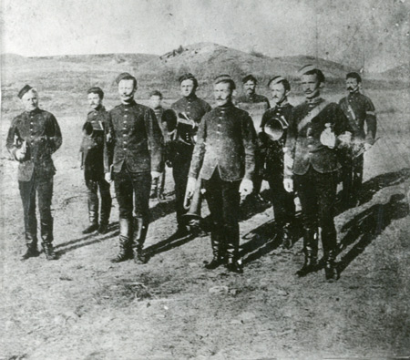 "1878 - Photograph of the NWMP band at Fort Walsh. Members in the photograph are (left to right): Boyld, Sinclair, Davis, S/M Lake, Pringle, Workman, Sgt. McDonell, O'Keff, Brown and Cpl. Parks. (Source of photo - RCMP Historical Collections Unit - ""Depot"" Division)."