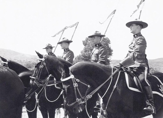 Photograph of RCMP Musical Ride members.  Mel McIntosh is third from the right (Source of photo - Ric Hall's Photo Collection).