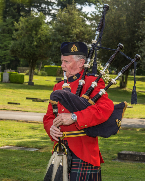 Photograph of an RCMP piper who played Amazing Grace (Source of photo - Sheldon Boles).