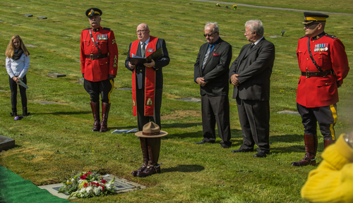 Photograph of RCMP Chaplain Jim Turner leading the memorial service for Cst. Kenneth Kornelson.  Insp. Ted