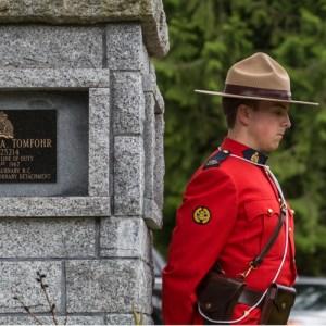 RCMP member stands at RCMP memorial (Source of photo - Sheldon Boles)
