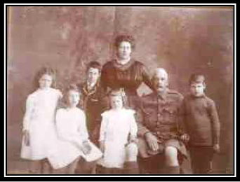 Photograph of Walter Wrixton de Rossiter with his wife Frances and children (from left to right) Frances, Annie, Edward, Connie and Ross.