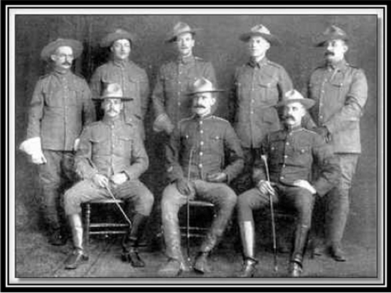 Photograph of the 4th Regiment Canadian Mounted Rifles members. Water de Rossiter is seated in the front row on the extreme right.