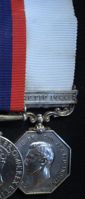 Photograph of the Arctic Medal with the 1944 Bar presented to all members of St. Roch who were on the trip from Vancouver to Halifax Nova Scotia.
