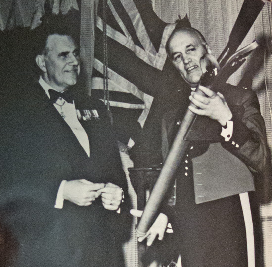 Photograph of RCMP Commissioner William Higgitt presenting a RCMP 1873-1973 Centennial Winchester rifle to NWT Commissioner Stuart Hodgson (Source of photo - RCMP Quarterly Magazine edition