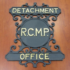 Photograph of a RCMP Detachment Office sign (Source of photo - Ric Hall's Photo Collection).