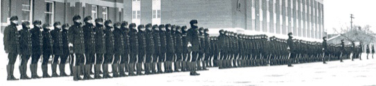 """Photograph of RCMP Recruits on Parade in the winter at """"Depot"""" Division (Source of photo - Ric Hall's Photo Collection)."""