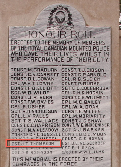 """Photograph of the RCMP Cenotaph at """"Depot"""" Division in Regina with the name of"""