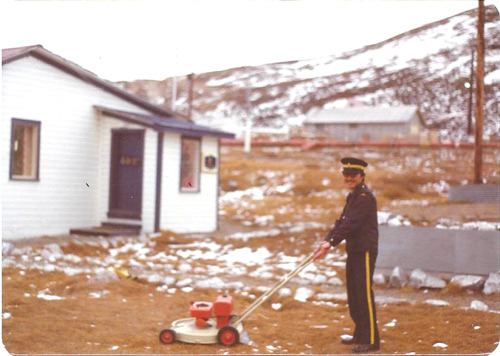Photograph taken at the RCMP Pond Inlet Detachment with the Special Constable with the Force provided lawn mower - taken by Jacques Drisdelle.