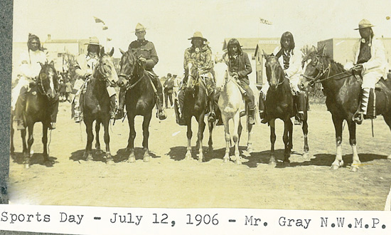 July 12, 1906 - The photograph was possibly taken at waned Saskatchewan is very interesting.  Chief Sabitawasis (far right in the photo) is shown with his 'white' trench coat and colourful leggings while the young native gentleman (on horse second to the right of NWMP Mr. Gray) is wearing a 3 piece suite.  Then there's Chief Sabitawasis' headers .. a Mounted Police Stetson.