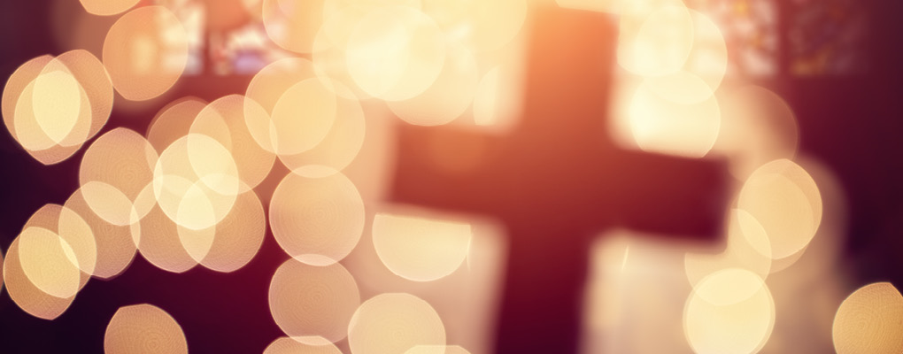 bokeh effect around cross.