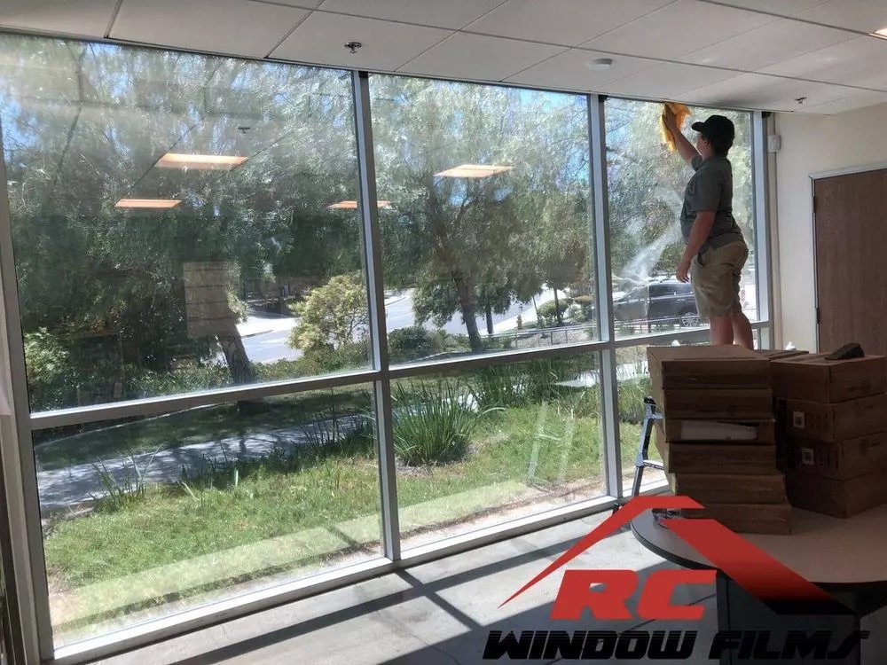 Reduce energy bill by window tinting your property